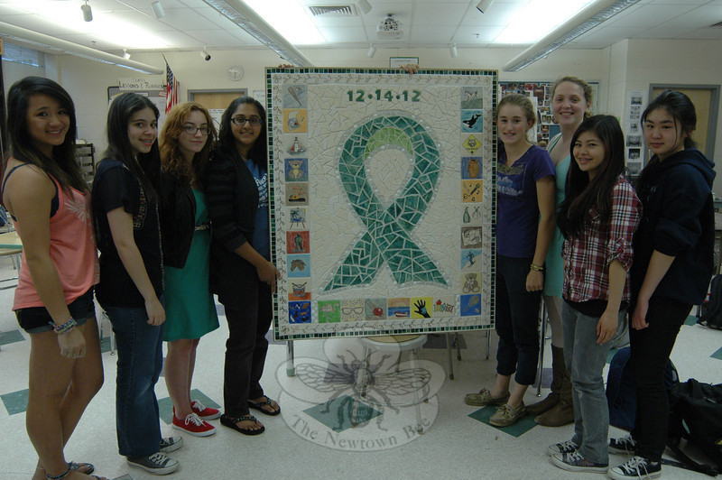 Newtown High School Art Club members with the mosaic created by club members with help from art students at the school in response to the events in Sandy Hook on 12/14.   (Hallabeck photo)