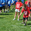 Enthusiasm was as high as the temperature, Friday, May 31, as Head O' Meadow Elementary School students gathered in the field behind the school to take part in Spirit Day. Nicholas Psichopaidas, second grade, takes his turn at target toss, while classmate Molly Lyddy looks on with the others.   (Crevier photo)