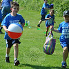 Enthusiasm was as high as the temperature, Friday, May 31, as Head O' Meadow Elementary School students gathered in the field behind the school to take part in Spirit Day. First graders Michael Poidonani and Gavin Knop head to the Beach Day Relay finish line, beach ball and beach bag in hand.   (Crevier photo)