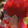 Enthusiasm was as high as the temperature, Friday, May 31, as Head O' Meadow Elementary School students gathered in the field behind the school to take part in Spirit Day. Kindergarten through fourth grade teams dressed in red, blue, yellow, and green — and many with hair dyed and faces painted to match —  took turns competing in an obstacle course, sack race, soccer dribble, target toss, 50-yard dash, a beach day relay, and a water balloon toss. Patrick Mahoney, second grade, carried his spirit for his red team to new (hair) heights, with a red spiked wig and bright red mustache.   (Crevier photo)