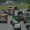 Near the end of the morning rush on a rainy June 3, a three-vehicle accident occurred on westbound Interstate 84, about 500 feet west of the Currituck Road overpass, causing travel delays in the area. The 8:36 am accident involved vehicles that were traveling in the left lane of three lanes — two 2011 Cadillac limousines owned by a West Haven livery firm and a 2006 Saturn Vue SUV, state police said. A 2011 Cadillac driven by David Gardner, 69, of Wallingford stopped for traffic conditions and a 2011 Cadillac driven by Joseph Nacca, 66, of West Haven then stopped behind it, state police said. The Saturn, driven by Helen Neckles, 77, of Southbury, then drove into the rear end of the Cadillac driven by Nacca, pushing that vehicle into the rear end of the Cadillac driven by Gardner, state police said. Nacca received a possible injury, state police said. State police said they cited Neckles for following too closely.   (Gorosko photo)