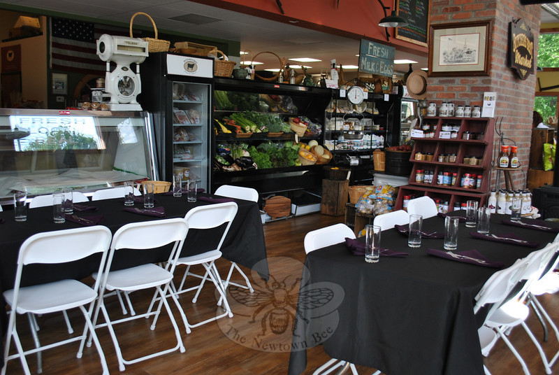 "Tables and chairs ""pop up"" inside Steve Ford's Butcher's Best shop on South Main Street, elegantly dressed and ready for Dinner Underground guests.  (Crevier photo)"