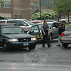 Newtown Police Officer Paula Wickman and Detective Joe Joudy checked vehicles entering the Hawley School parking lot on Monday afternoon.  (Gorosko photo)