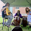 Local musicians Joe Proc, left, Abu Carter, center, and Julie Ketchum quickly packed their gear at The Farmers Market at Fairfield Hills Tuesday as a thunderstorm threatened, June 18. (Bobowick photo)