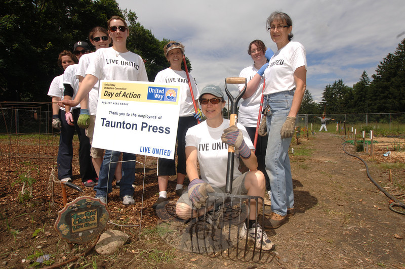 Taunton Press volunteers at the Victory Garden to help lay down mulch, top soil and clear weeds included, from left, Paula Ferreri, EvaMarie Gomez, Victoria North, Deana May, Chris Lincoln, Laura Burrone, Caryne-Lynne Davis, and Nancy Boudreau.   —Bee Photo, Bobowick