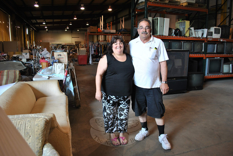 Anita Pettengill and Dan Telesco stand in one portion of the 56,000-square-foot warehouse on High Bridge Road that houses all of the donations to their nonprofit organization, Make A Home Foundation, Inc. The couple has recently received the certificate of occupancy for the space, allowing them to open to the public, nine days each month. Money from sales will help cover overhead costs for the foundation.    —Bee Photo, Crevier