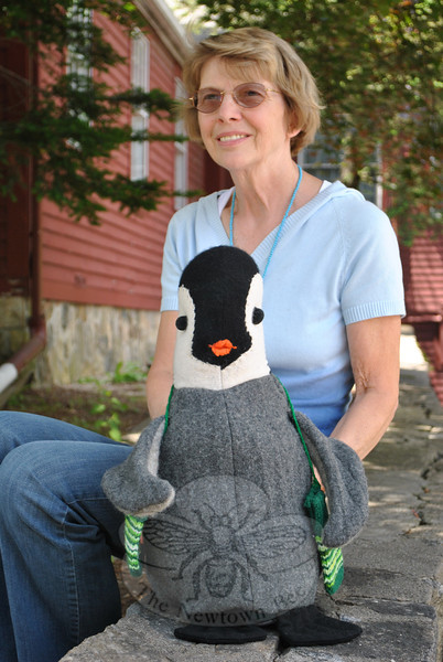 "We had a visitor at The Bee office late last week. Marjorie Czarsty, an amazing seamstress, stopped by to show us her ""Pinghu,"" a stuffed penguin she created from old sweaters, for her granddaughter. Marjorie volunteers with The Cornerstone in Newtown, and rather than toss out the old wool sweaters the consignment shop receives that can't be sold, she cuts them up, felts the pieces, and creates felted wool purses — and penguins. Marjorie even knitted little mittens for the penguin. Pinghu is already destined for his new home, in the arms of Marjorie's granddaughter.—Bee Photo, Crevier"