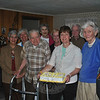 Members of Newtown Meals On Wheels and first selectman Pat Llodra celebrate the 100th birthday of local recipient Marshall Zitnay, Thursday, June 7, at a surprise birthday party. Pictured from left are Mary Powers, Marilyn Alexander, Marshall Zitnay, Ellyn Gehrett, Pat Llodra, Lucille LaPerch (with cake), Tom Powers, Carm O'Neil, and Wendy Wipprecht.   —Bee Photo, Crevier