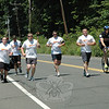 Newtown police and Bethel police participated in the June 8 Newtown leg of the Special Olympics Torch Run, a fundraising event that promotes the Special Olympics of Connecticut. This year four Newtown police and two Bethel police took part in the Newtown leg of the event. While running on Dodgingtown Road (Route 302) in Dodgingtown, Newtown Officer Jeff Silver, third from left, carried the Special Olympics torch. Also shown, from left, are Newtown Officer John McDermott, Bethel Officer James Christos, Bethel Officer Will HoLland, Newtown Officer Bart Lorancaitis, and Newtown Officer Will Chapman riding a bicycle.    —Bee Photo, Gorosko
