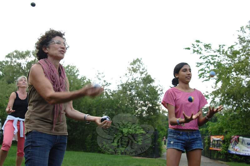 Resident Billie Cohen and her daughter Usha Honeiy practice their juggling Sunday, June 10, at Dickinson Park, during Park & Rec's Sample Camp. —Bee Photo, Bobowick
