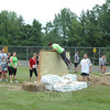The Mad Dash debuted June 9 at Fairfield Hills, hosted by Newtown Youth Academy and the Newtown Parks & Recreation Department. Hundreds of adults and children traversed tunnels, hay bales, a mud pit and balance beams while being doused by water hoses handled by Newtown Hook & Ladder volunteers. —Bee Photo, Voket