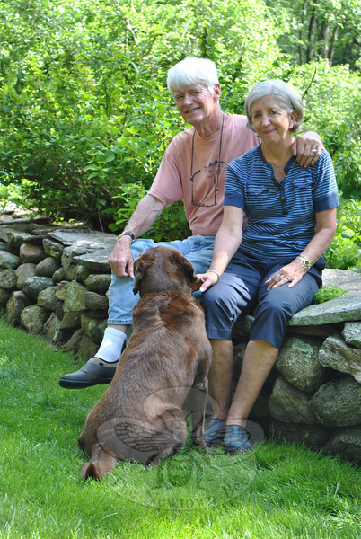 "A flat, lichen-covered rock from the Catskills caps a portion of the nearly 200-feet of stone wall Frank Gardner has built along the edge of his property, and is the perfect perch for him and wife, Jan, to rest from gardening chores and visit with their dog, Abby.    —Bee Photo, Crevier<br /> <br /> PLEASE NOTE: The full collection of photos that made up the slideshow that accompanied this story online can be found in a separate gallery, here: <a href=""http://photos.newtownbee.com/Journalism/Glimpse-of-The-Garden-Jan-and/23644367_LmktFx#!i=1913462827&k=zMvdDhH"">http://photos.newtownbee.com/Journalism/Glimpse-of-The-Garden-Jan-and/23644367_LmktFx#!i=1913462827&k=zMvdDhH</a>"