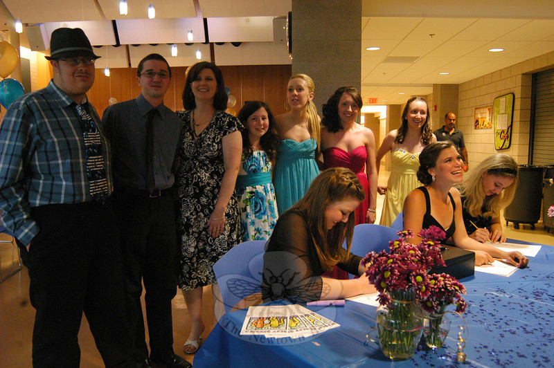 A group of attendees at the Friday, June 1, Best Buddies Prom stood near the welcome booth set up for the event. Best Buddies club advisor and Newtown High School special education teacher Jill Gonski, third from the left, also stood with the students for the photo. —Bee Photo, Hallabeck