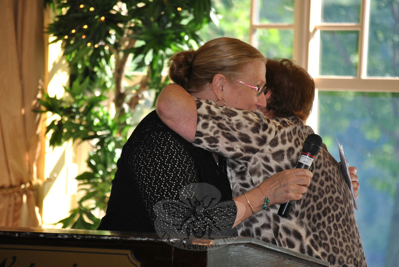 "Hospice Breakfast keynote speaker Gail Honychurch, left, receives a hug from Newtown Chapter Hospice Breakfast Co-chair Marg Studley, Wednesday morning, June 6. Ms Honychurch spoke on her experiences as a volunteer with Western Connecticut Regional Hospice and Home Care and the Healing Hearts program.   (Crevier photo)<br /> <br /> PLEASE NOTE: The full collection of photos that made up the slideshow that accompanied this story online can be found in a separate gallery, here: <a href=""http://photos.newtownbee.com/Journalism/Special-Events/Regional-Hospice-Home-Care-of/23502795_6FPV3X#!i=1899785110&k=C8CPjmq"">http://photos.newtownbee.com/Journalism/Special-Events/Regional-Hospice-Home-Care-of/23502795_6FPV3X#!i=1899785110&k=C8CPjmq</a>"