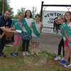 Assistant Animal Control Officer Matt Schaub receives a check for more than $150 from members of Girl Scout Troop 50478. From left are Caitlyn Greenspan, Natalie Horn, Carla Fabrizio, Julie Tobin, Amanda Johnson, and Holly Ankers.    —Bee Photo, Bobowick