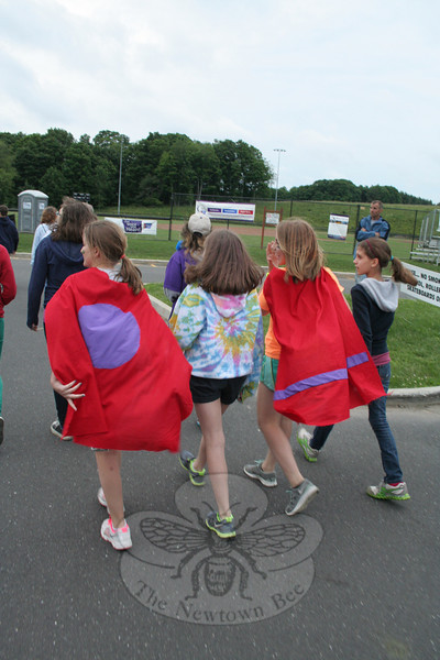 "The 2012 Newtown Relay for Life adopted a super heroes theme and as a result, many participants created various costumes and tent site references to heroes both real and fictional. Here a group of youth participants don capes for a lap around the Fairfield Hills course. 				—Bee Photo, Hicks<br /> <br /> PLEASE NOTE: The full collection of photos that made up the slideshow that accompanied this story online can be found in a separate gallery, here: <a href=""http://newtownbee.smugmug.com/Journalism/Special-Events/Relay-For-Life-2012/23520226_GnhFcF#!i=1901612363&k=2f3PfVZ"">http://newtownbee.smugmug.com/Journalism/Special-Events/Relay-For-Life-2012/23520226_GnhFcF#!i=1901612363&k=2f3PfVZ</a>"