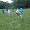 Students in Sandy Hook School's Marathon Mondays club ran with advisor and first grade teacher Kaitlin Roig on Monday, June 4, to complete the final mile of the group's 26.2-mile goal for the school year.   —Bee Photo, Hallabeck
