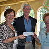 "Newtown Chapter Hospice Breakfast Co-chairs Marg Studley, left, and Marie Sturdevant, right, accepted a check for $750 from Newtown Lions Club President Ray Keegan, following the annual Hospice Breakfast, June 6.  (Crevier photo)<br /> <br /> PLEASE NOTE: The full collection of photos that made up the slideshow that accompanied this story online can be found in a separate gallery, here: <a href=""http://photos.newtownbee.com/Journalism/Special-Events/Regional-Hospice-Home-Care-of/23502795_6FPV3X#!i=1899785110&k=C8CPjmq"">http://photos.newtownbee.com/Journalism/Special-Events/Regional-Hospice-Home-Care-of/23502795_6FPV3X#!i=1899785110&k=C8CPjmq</a>"