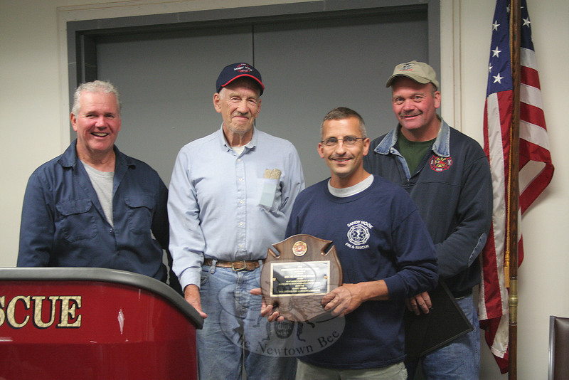 """Sandy Hook Fire & Rescue Firefighter Richard """"Archie"""" Paloian was named 2012 Outstanding Firefighter of the Year during the company's annual meeting on June 4. With him, from left, are Steve Stohl, Ken Carlson, and Chuck Kilson, members of the Outstanding Member Committee.    —Bee Photo, Hicks"""