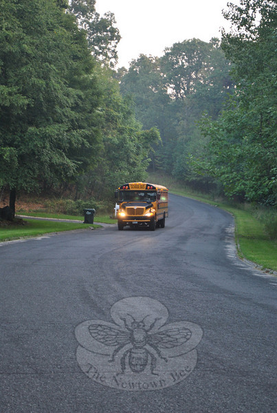 Bus 32 makes its way down Cobblestone Road early Wednesday morning, already filled with students eager for the first day of school.  (Crevier photo)
