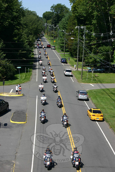 The 2010 CT United Ride had an escort of motorcycle police from 13 towns and the Connecticut State Police, seen here as the front escort group was approaching the Hook & Ladder and Sandy Hook ladder trucks.  (Hicks photo)