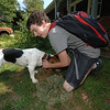David Kent reunites after a day away from his dog Bella as he returns home from school.  (Bobowick photo)
