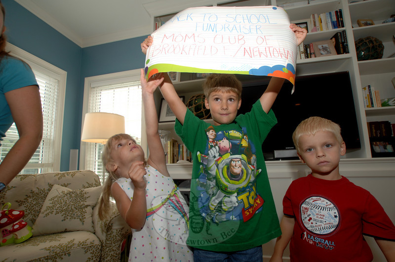 Fighting for the sign is Katherine Brooks, but older brother Christopher uses his extra height to hold the sign away from her and their brother Matthew.  (Bobowick photo)