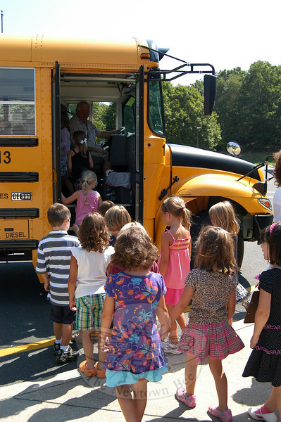 Head O' Meadow kindergarteners were greeted by owner/operator Phil Carroll when they received their first ride on a bus on Tuesday, August 31, the day before school began in the district.  (Hallabeck photo)
