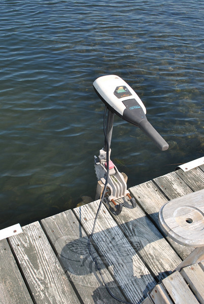 By securing a 2-by-6 to one side of his platform dock after a spring storm ripped it free of the gangway, and bolting this 12-volt battery-operated motor to it, Rob Lynders has developed a motorized dock that allows his family and friends to escape to the center of Taunton Lake, far from the weedy shoreline.  (Crevier photo)