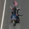 Like this pair, a number of the rider-passenger teams that participated in the 2010 CT United Ride had their own American flags flying.  (Hicks photo)