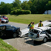 Wrecking crews removed damaged autos from a three-vehicle accident that occurred about 11 am on Saturday, August 28, on westbound Interstate 84, just east of the Exit 9 off-ramp, while members of Newtown Hook & Ladder wait to clear the scene. The collision sent four people to the hospital for medical treatment. The incident caused extensive travel delays on westbound I-84, resulting in traffic congestion on adjacent secondary roads.  (Hicks photo)