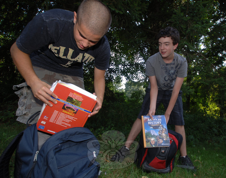 James Leuci, left, and neighbor David Kent hopped off the bus after their first day of eighth grade at Newtown Middle School on Wednesday, September 1.  (Bobowick photo)