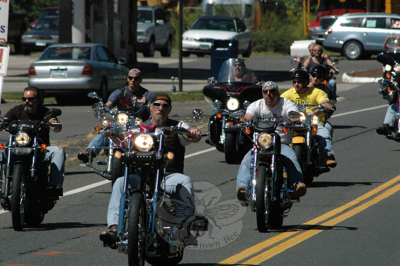 A cluster of motorcyclists taking part in the CT United Ride travel on Dodgingtown Road through Dodgingtown Center.  (Gorosko photo)