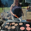 Dawn Lewis cooked hamburgers and hot dogs those attending a picnic on Saturday at the Dodgingtown Firehouse that celebrated the arrival of the fire company's new Rescue/Engine 221.  (Gorosko photo)