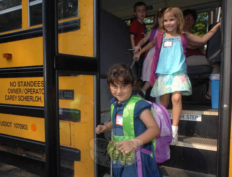 Maleeha Ali returned home and said she liked her first day in the first grade at Sandy Hook School. On the steps behind her is Jordan Gomes, who smiled when she saw her mother waiting for her at the bus stop.  (Bobowick photo)
