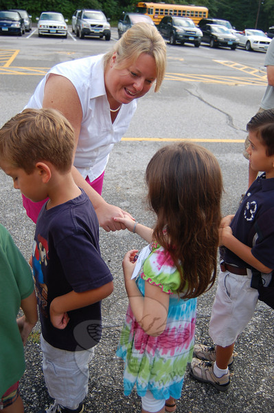 Sandy Hook Assistant Principal Jennifer Sinal greeted kindergarten students at the school on Thursday, August 26, for their preschool year visit to Sandy Hook School.  (Hallabeck photo)