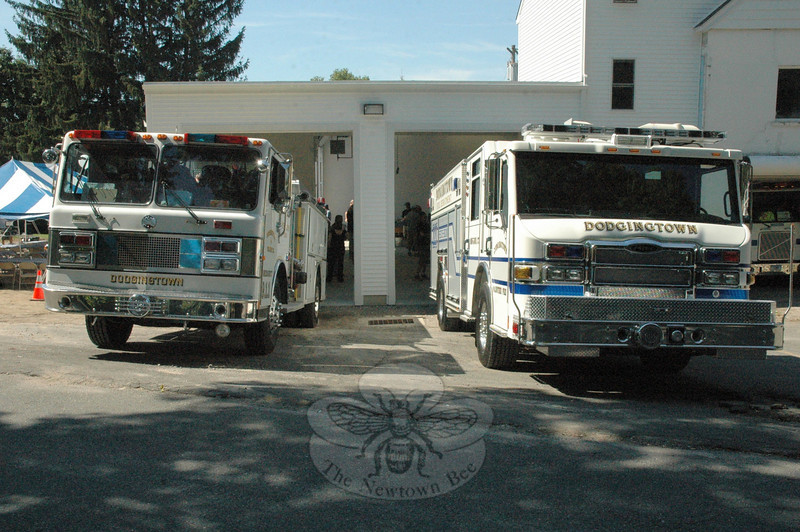 Dodgingtown firefighters' new Rescue/Engine 221, at right, is entering service to replace the fire truck on the left, which is more than 20 years old. The vehicles are positioned in front of new garage space that recently was added to the Dodgingtown Firehouse on Dodgingtown Road (Route 302).  (Gorosko photo)