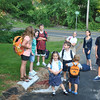 A cluster of neighborhood youngsters wait for the buses that will take them to Newtown and St Rose schools early on Wednesday morning, September 1, the first day of school for the Newtown School District.  (Crevier photo)