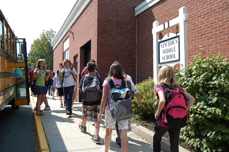 Newtown Middle School students walked to find their bus after completing their first day  of school.  (Hallabeck photo)