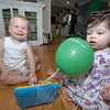 Payton Camp smiles with excitement while his play date Emily Sachs tugs on a balloon.  (Bobowick photo)