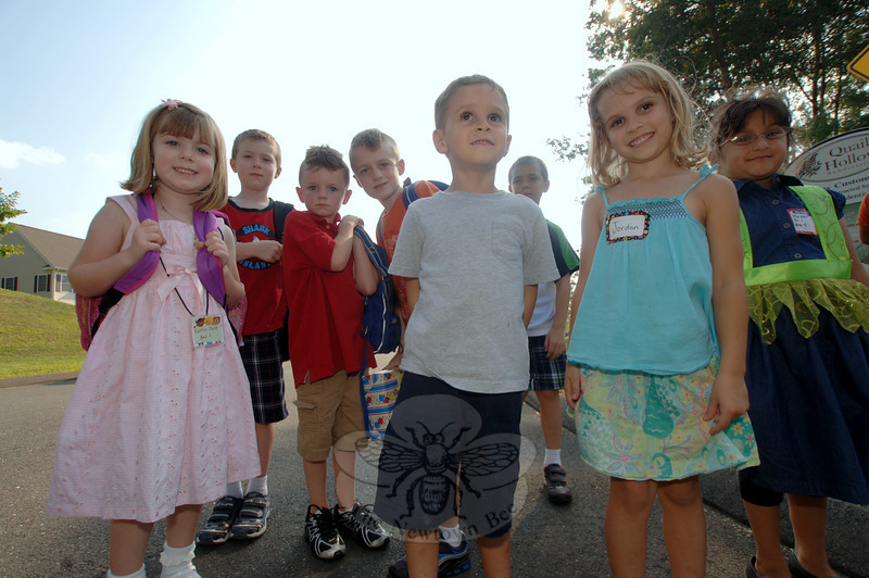 A happy group of neighborhood children returned from their first day back to school Wednesday. From left are Kaitlin Dole, Riley Dole, Rowan Coffey, Kiernan Coffey, Lucas Gomes, Jordan Gomes, and behind them is Conor Dole, and on the far right is Maleeha Ali.  (Bobowick photo)