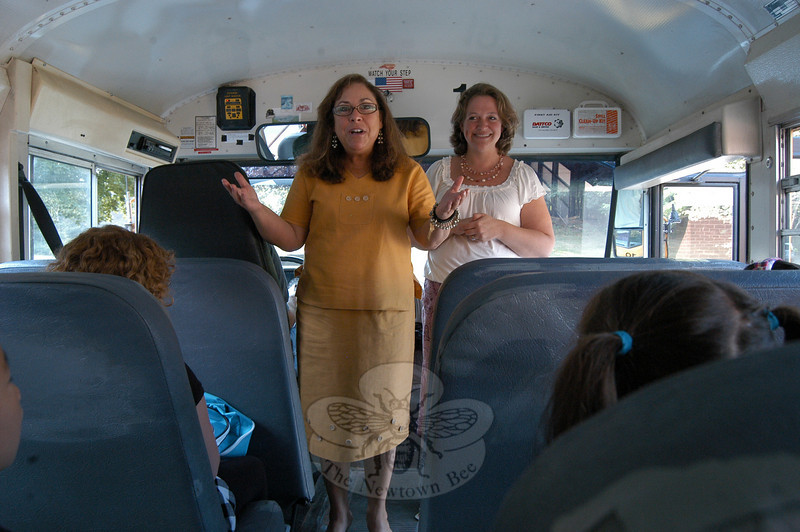 Sandy Hook School Principal Barbara Gasparine (center) and newly named lead teacher Jennifer Meyers (right) welcomed students to the 2010-11 school year by getting on each bus as it arrived at the school.  (Hallabeck photo)