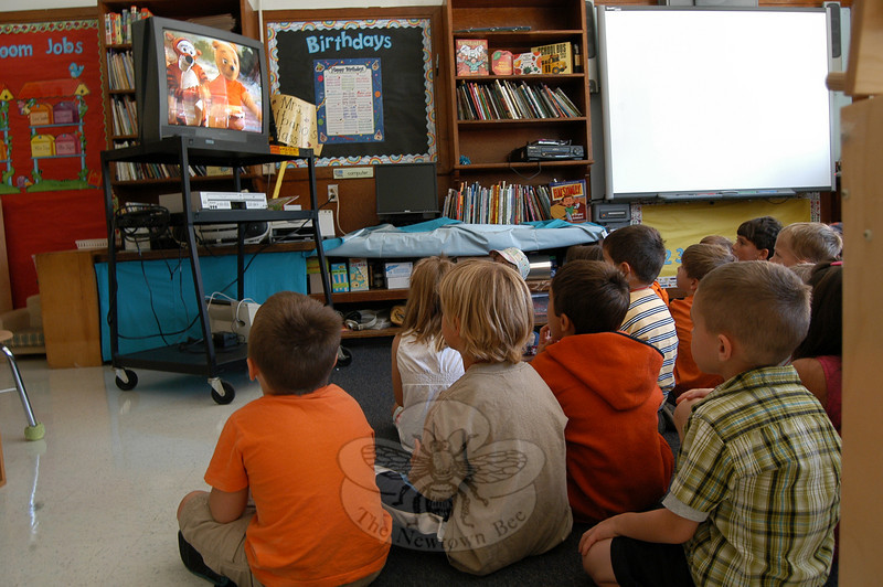 Hawley School kindergarten students watched a movie showing Winnie The Pooh and friends to help learn about bus safety on Friday, August 27.  (Hallabeck photo)
