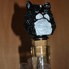 "A cat cork bottle stopper is the ""purr-fect"" way to express affection for a particular cat breed and keep the leftover wine in ""purr-fect"" condition. This tuxedo cat is a custom design hand painted by Jacqueline Adams, and one of hundreds of cat and dog products she wholesales every year.  (Crevier photo)"