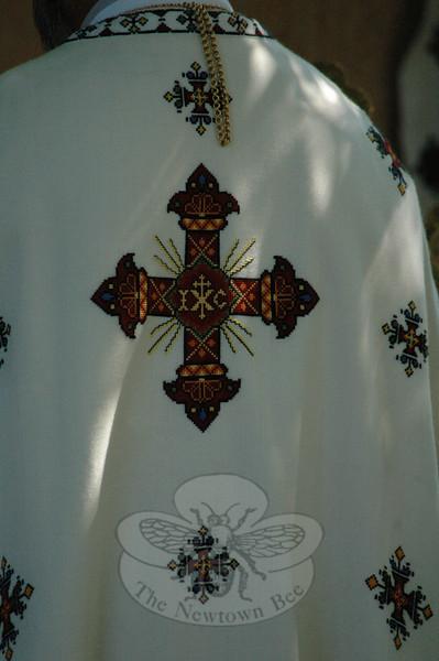 The religious vestments bear ornate symbols.  (Gorosko photo)
