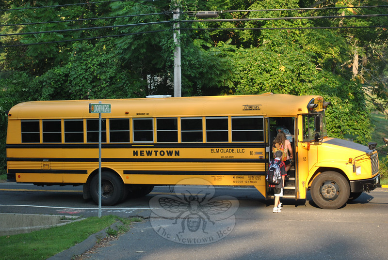Bus 18 makes a quick stop at the corner of Longview Heights and Route 302 to take on first day of school passengers.  (Crevier photo)
