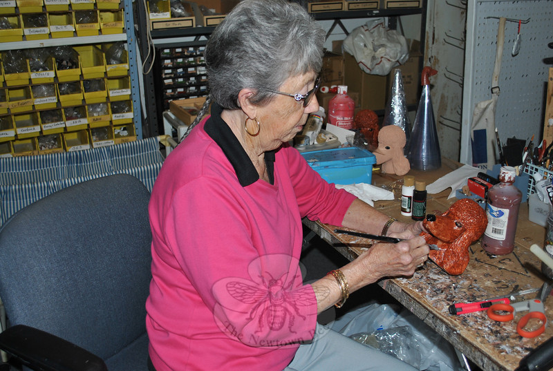 "During the busy holiday season, Ms Adams will spend nearly 12 hours a day working in her basement workshop to add detail finish to thousands of dog and cat heads for the popular pet angel tree topper, pet ""Santa"" figures, ornaments, and other items that appeal to a pet loving population. Her business, Jacqueline's Originals, has thrived for over four decades.  (Crevier photo)"