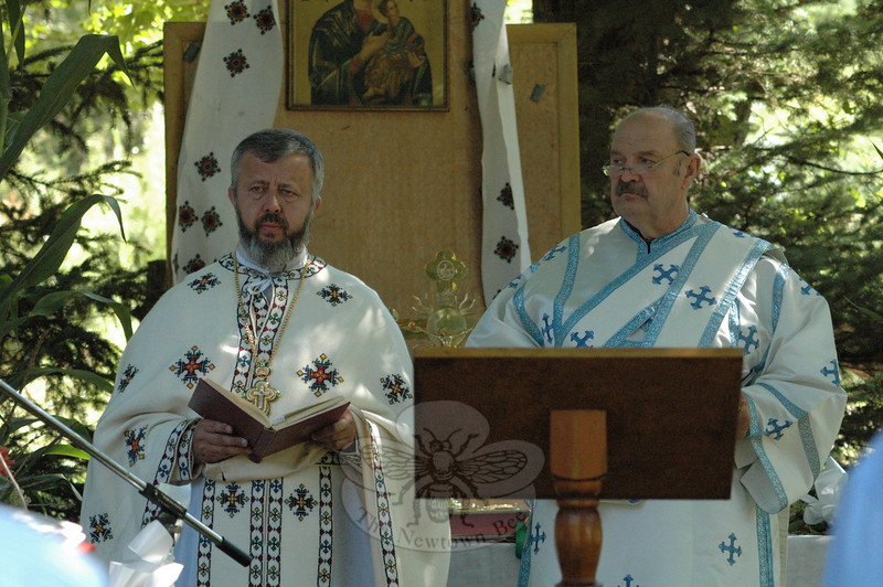 Mass was celebrated at the 35th Annual Ukrainian Festival held Sunday, August 29, at the Paproski Christmas Tree Farm on Hattertown Road. Conducting Mass were The Right Reverend Mitred Archpriest Mihai Dubovici, left, and Deacon John Wanat. They are affiliated with Protection of The Blessed Virgin Mary Ukrainian Catholic Church of Bridgeport.  (Gorosko photo)