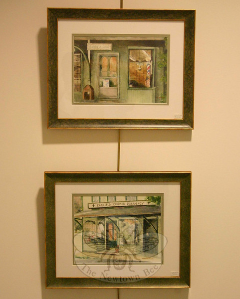 "While the first half of the exhibition's title is ""Newtown Images,"" art that evokes scenes of New England were also encouraged for the inaugural art show at Newtown Municipal Center. Show here are ""Corner Barber Shop"" (top) and ""Canfield Corner Pharmacy,"" both by Mary Lou Staffiieri and both depicting locations in nearby Woodbury.  (Hicks photo)"
