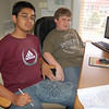 Newtown High School rising sophomores Saiful Islam, left, and Jason Sherwood worked Tuesday, July 13, at Newtown Youth & Family Service's Church Hill Road building to find places for local students and families to volunteer their time and efforts in Connecticut. Once roughly 50 places are listed, the students will interview representatives of the organizations and create a booklet.  (Hallabeck photo)